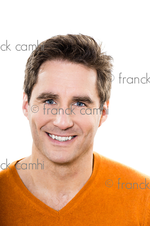 one  man mature handsome portrait blue eyes smiling portrait studio white background