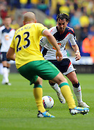 Picture by Chris Donnelly/Focus Images Ltd. 07500 903009 .17/9/11.Chris Eagles of Bolton and Marc Tierney of Norwich during the Barclays Premier League match at Reebok stadium, Bolton.