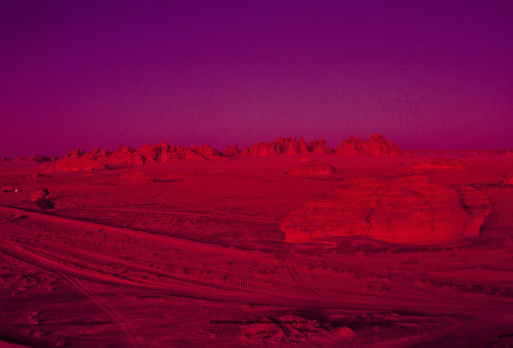 Mada'in Saleh, Nabataean archeological site. Occasionally during the winter a sunset will have this unique quality. Northwest Saudi Arabia.