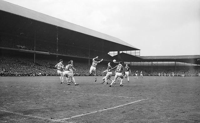 Kerry's J.J. Barrett punches ball to team mate during the All Ireland Senior Gaelic Football Final Kerry v. Galway in Croke Park on the 26th September 1965. Galway 0-12 Kerry 0-09.