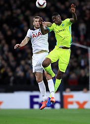 Tottenham Hotspur's Eric Dier (left) and K.A.A. Gent's Kalifa Coulibaly (right) battle for the ball battle for the ball in the air