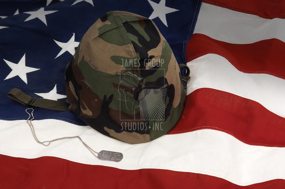 US Army helmet and dog tag on US flag background