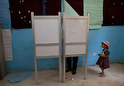 A little girl accompanies her grandfather to an polling station that separates male and female voters  in the Ein Champs neighborhood of Cairo, Egypt Thursday, May 24, 2012.  Egyptians voted Thursday on the second day of a landmark presidential election that will produce a successor to longtime authoritarian ruler Hosni Mubarak.(Photo by Heidi Levine/Sipa Press).