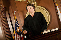 Judge forming a judgement in a courtroom