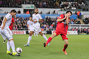 forward Reece Thompson closes down defender Angel Rangel during the Capital One Cup match between Swansea City and York City at the Liberty Stadium, Swansea, Wales on 25 August 2015. Photo by Simon Davies.