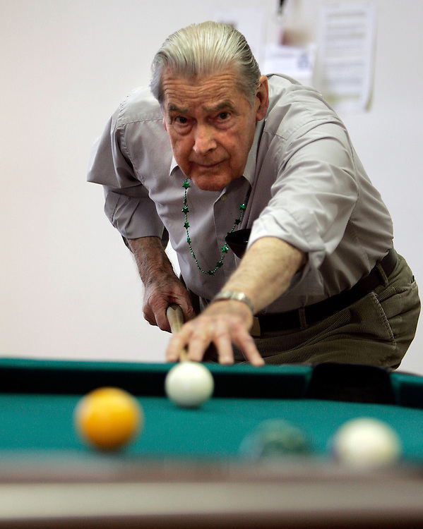 CAPTION ONLY: Hal Edison of Salt Lake City lines up a shot during a friendly game of pool at the Bountiful Golden Years Senior center Thursday Feb 1, 2007 in Salt Lake City, Utah. August Miller/Deseret Morning News