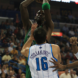 11 February 2009:  Boston Celtics forward Kevin Garnett (5) shoots over New Orleans Hornets forward Peja Stojakovic (16) during a NBA game between the Boston Celtics and the New Orleans Hornets at the New Orleans Arena in New Orleans, LA.