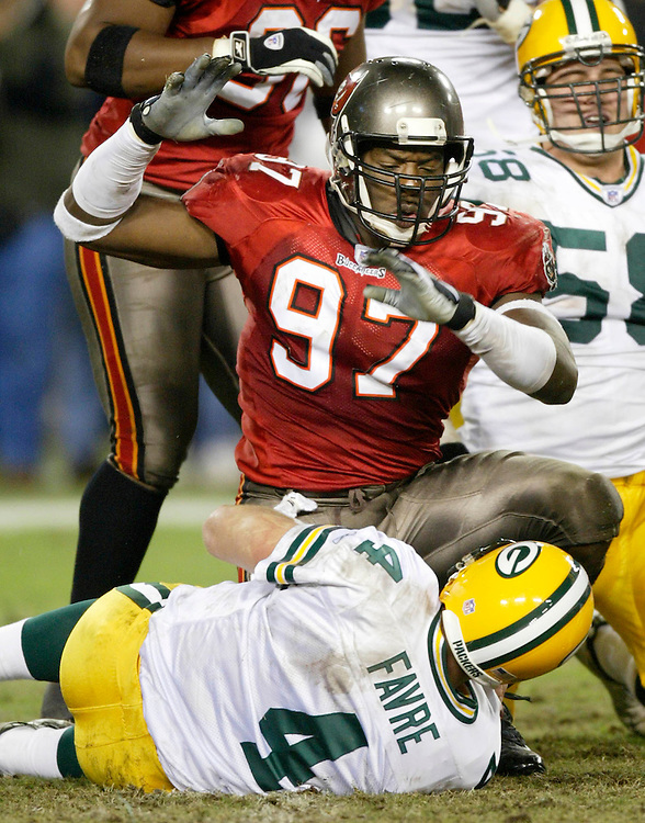 Tampa Bay Buccaneers' Simeon Rice (97) celebrates over Green Bay Packers quarterback Brett Favre (4) after sacking him during the fourth quarter on Sunday, Nov. 24, 2002 in Tampa, Fla. (AP Photo/Scott Audette)