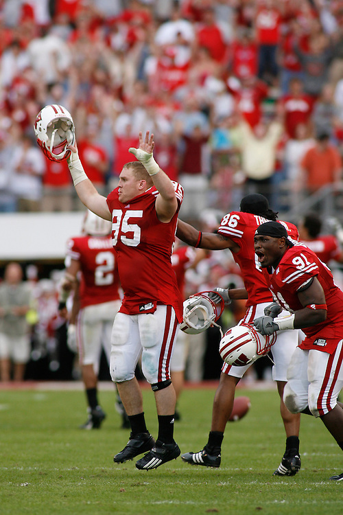 University of Wisconsin defensive lineman Joe Monty (95), wide receiver Elijah Theus (86) and defensive lineman Jason Chapman (91) celebrate after the Wisconsin Badgers 17-14 victory over the Arkansas Razorbacks on January 1, 2007 at the Florida Citrus Bowl Stadium in Orlando, Florida.