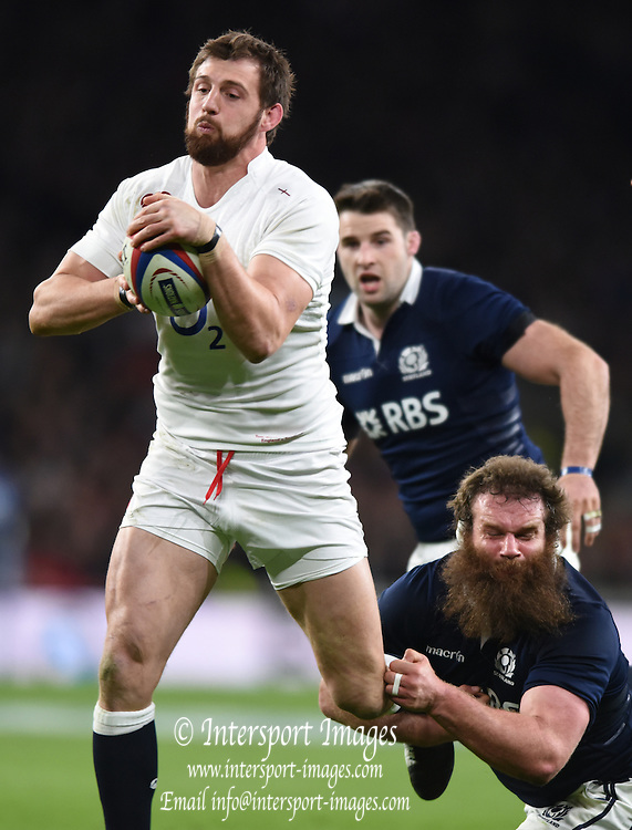 Twickenham, Great Britain, Tom WOOD, tackled by Geoff CROSS, during the Six Nations Rugby England vs Scotland, played at the RFU Stadium, Twickenham, ENGLAND. Saturday 14/03/2015<br /> <br /> [Mandatory Credit; Peter Spurrier/Intersport-images]