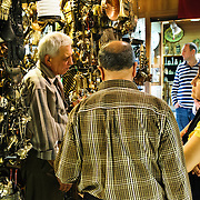 Customers haggle for price witha  shopkeeper in Istanbul's historic Grand Bazaar. Haggling is an essentail part of the buying and selling that goes on in the bazaar.