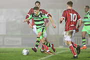 Forest Green Rovers Olly Mehew(29) skips through the Bristol City defence during the Gloucestershire Senior Cup match between Forest Green Rovers and U23 Bristol City at the New Lawn, Forest Green, United Kingdom on 9 April 2018. Picture by Shane Healey.