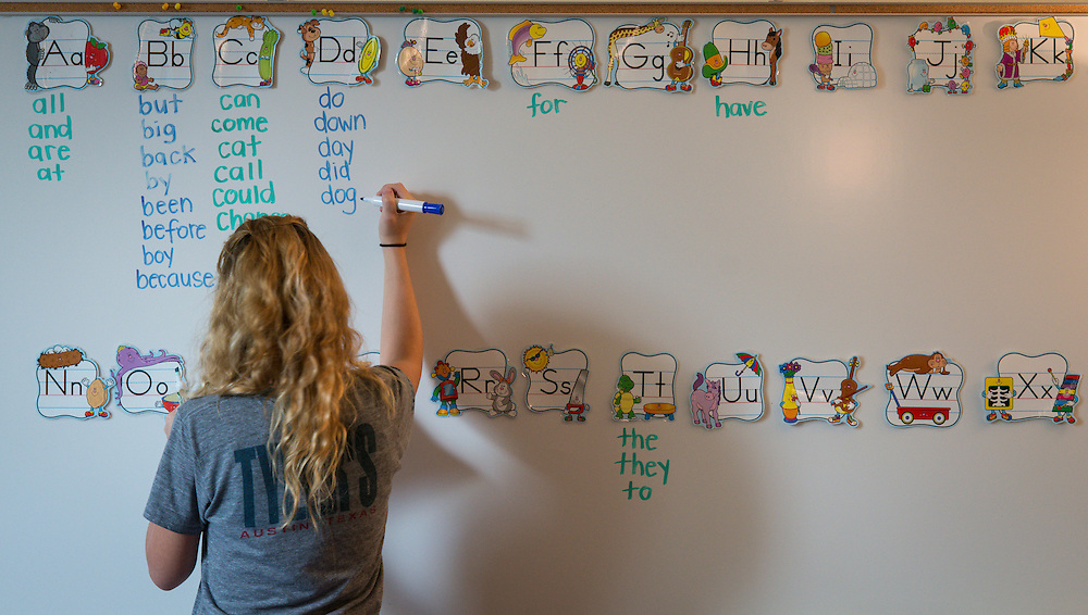 Paige Abergel organizes her first grade classroom in preparation for the first day of school at Southmayd Elementary School, August 18, 2014.