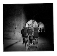 Transporting a mirror.  Xi'an, Shaanxi Province, China.  1996
