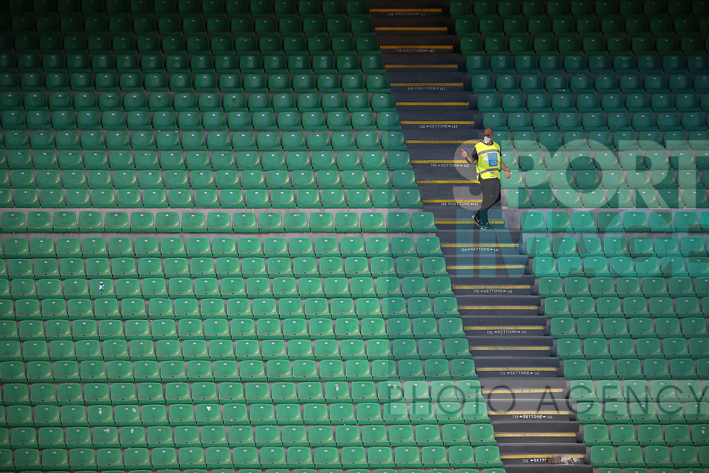 A lone steward gives a thumbs up signal in the empty stands during the Serie A match at Giuseppe Meazza, Milan. Picture date: 28th June 2020. Picture credit should read: Jonathan Moscrop/Sportimage