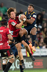 Crusaders' George Bridge, left, and Highlanders' Waisake Naholo, compete for the high ball in the Super Rugby match, Forsyth Barr Stadium, Dunedin, New Zealand, Saturday, March 17, 2018. Credit:SNPA / Adam Binns ** NO ARCHIVING**