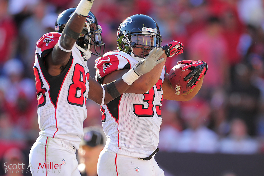 Atlanta Falcons running back Michael Turner (33) celebrates with wide receiver Harry Douglas (83) in the fourth quarter of the Flacons 24-23 win against the Tampa Bay Buccaneers at Raymond James on November 25, 2012 in Tampa, Florida.  Atlanta won 24-23...©2012 Scott A. Miller.