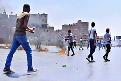 19.03.2014, Giza, EGY, Ausschreitungen in Ägypten, im Bild Proteste gegen das Todesurteil von EX Präsident Mohammed Mursi // Supporters of the Muslim Brotherhood set fire on the ring road of al-moneeb district, in a protest to mark Friday's second anniversary of the military s overthrow of Islamist President Mohammed Morsi, Egypt on 2014/03/19. EXPA Pictures © 2015, PhotoCredit: EXPA/ APAimages/ Amr Sayed<br /> <br /> *****ATTENTION - for AUT, GER, SUI, ITA, POL, CRO, SRB only*****