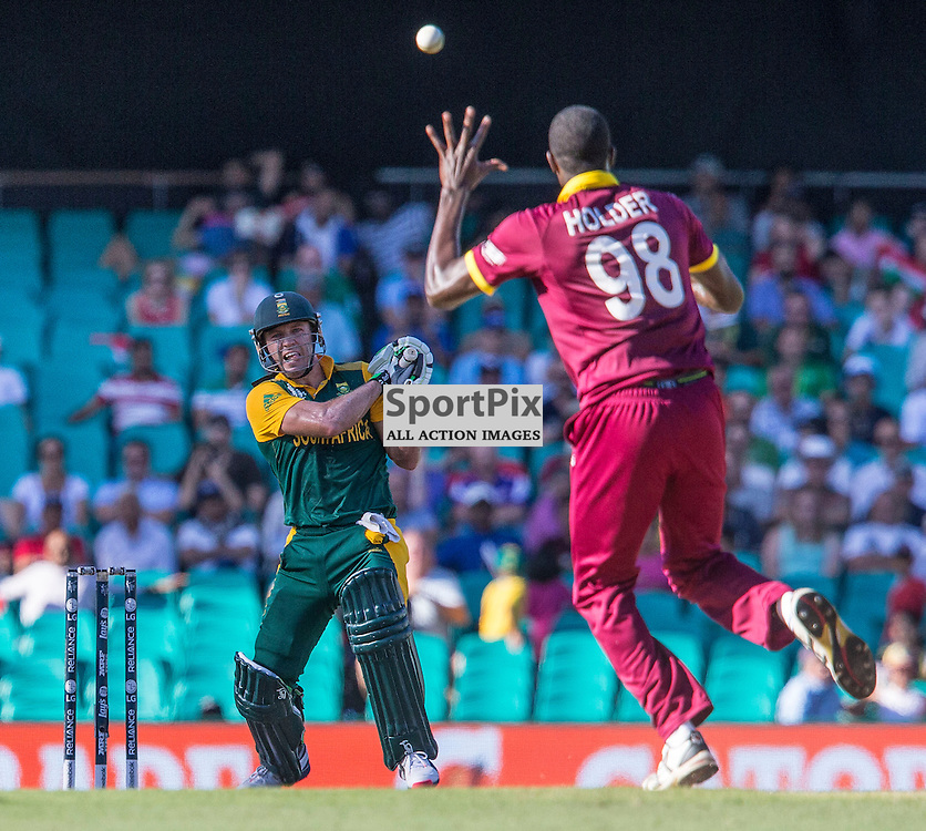 ICC Cricket World Cup 2015 Tournament Match, South Africa v West Indies, Sydney Cricket Ground; 27th February 2015<br /> South Africa&rsquo;s AB De Villiers smashes a shot over West Indies Jason Holder