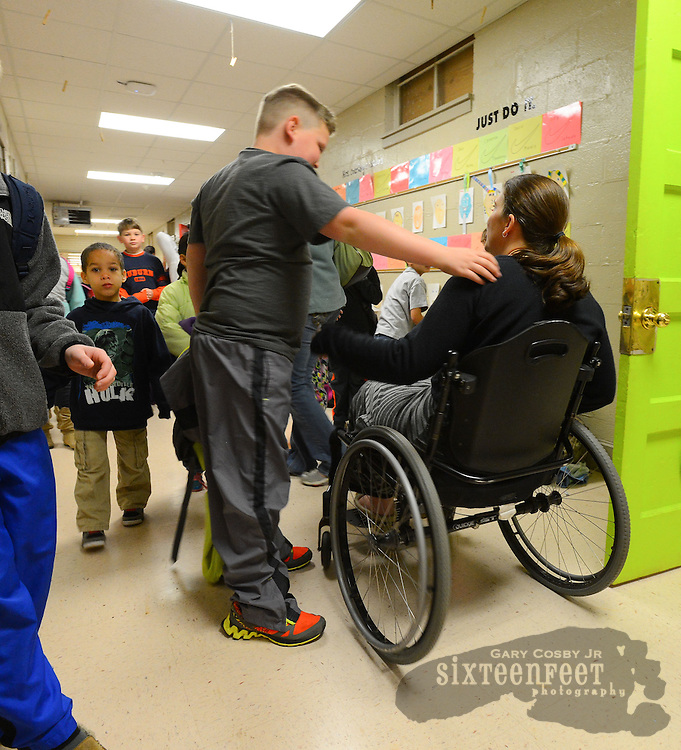 Gary Cosby Jr./Decatur Daily    Courtney Carpenter Boyll was a rising star athlete in 1994 when a car wreck left her paralyzed.   Twenty years later she is a wife, mother of three and third grade teacher and does it all as a paraplegic.  Students greet Courtney with hugs in the hallway at Moulton Elementary School.