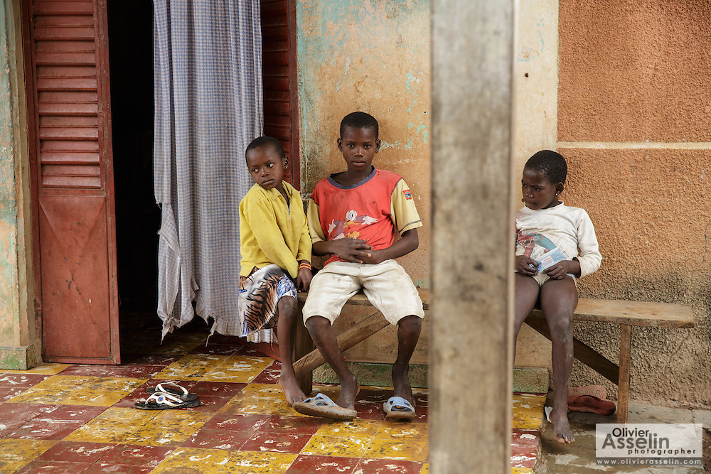 Children on the porch of a home in Katiola, Cote d'Ivoire on Friday July 12, 2013.