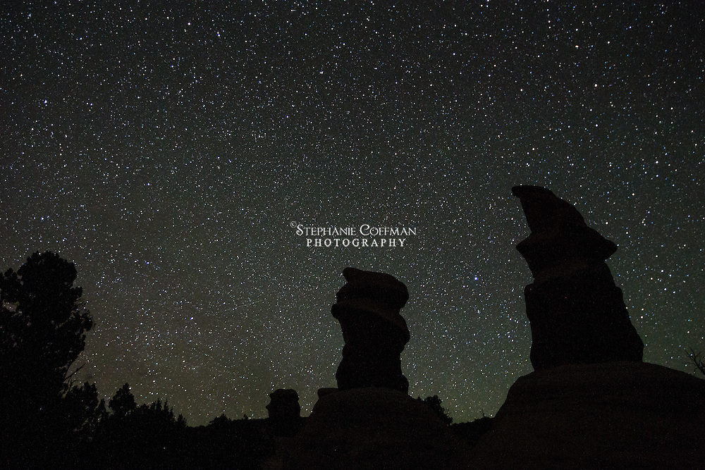 Stars light up the night sky above hoodoos in Devil's Garden in the Grand Staircase-Escalante National Monument, Utah