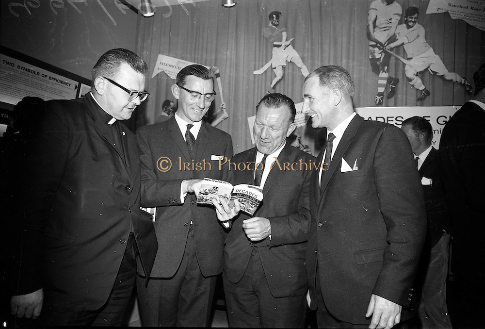 "17/05/1966<br /> 05/17/1966<br /> 17 May 1966<br /> Book reception for ""Decades of Glory: A Comprehensive History of the National Game"" by Raymond Smith.<br /> This reception was held in the offices of W.D. & H.O. Wills to honour the well known author and journalist, Raymond Smith. His book on the history of Hurling (""Decades of Glory"") has just been published with the assistance of Wills of Dublin and Cork and the Central Council of the G.A.A.<br /> Picture shows (from left to right): Rev. Patrick Murray (Pallottine Father), Raymond Smith (Author), Seán Ó Síocháin (General Secretary of the G.A.A.), and Gerry Glenn."
