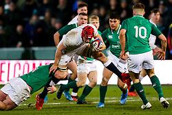 Richard Capstick of England U20 is tackled by itMarcus Hanan of Ireland U20 - Rogan/JMP - 21/02/2020 - Franklin's Gardens - Northampton, England - England U20 v Ireland U20 - Under 20 Six Nations.
