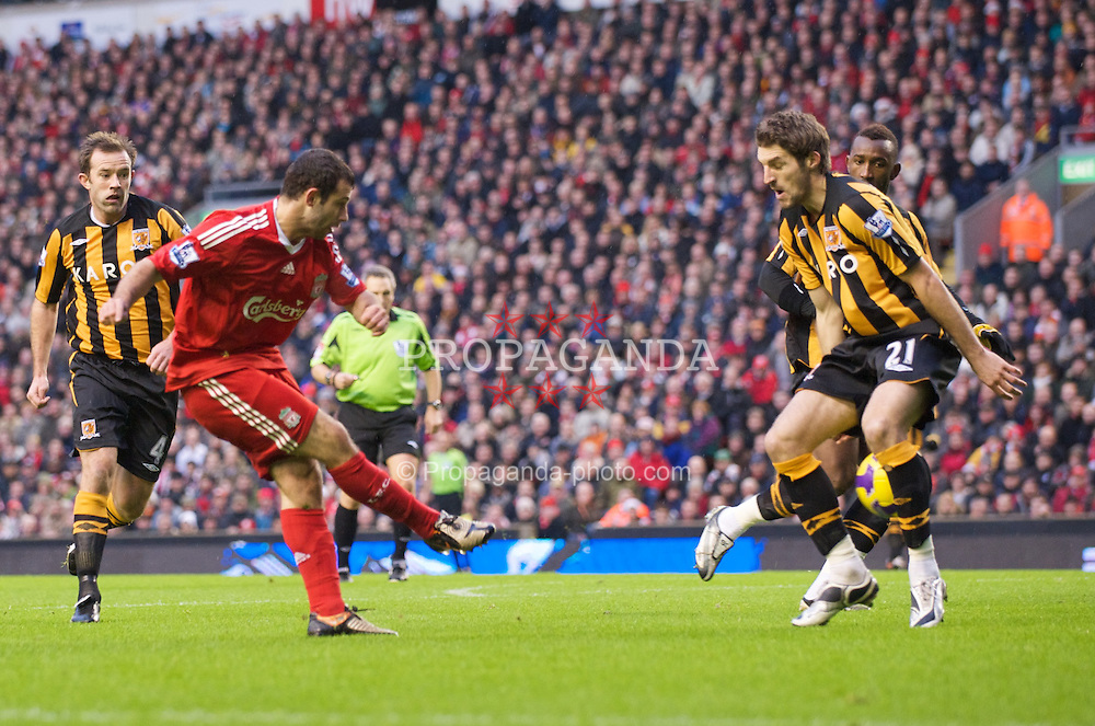 LIVERPOOL, ENGLAND - Saturday, December 13, 2008: Liverpool's Javier Mascherano nutmegs Hull City's Samuel Ricketts during the Premiership match at Anfield. (Photo by David Rawcliffe/Propaganda)