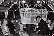 Teenagers on the tube with a CND banner, London, UK, 1983