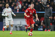 Bayern Munich midfielder Franck Ribery (7) running forward for the ball but is flagged off-side, Liverpool forward Mohamed Salah (11) and Liverpool manager Jurgen Klopp in the background, during the Champions League match between Bayern Munich and Liverpool at the Allianz Arena, Munich, Germany, on 13 March 2019.