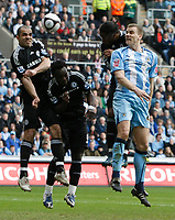 Photo: Steve Bond/Richard Lane Photography.<br />Coventry City v Chelsea. FA Cup 6th Round. 07/03/2009. Ben Turner (R) heads for goal as Alex (L) Michael Essien (CL) and Didier Drogba (CR) defend