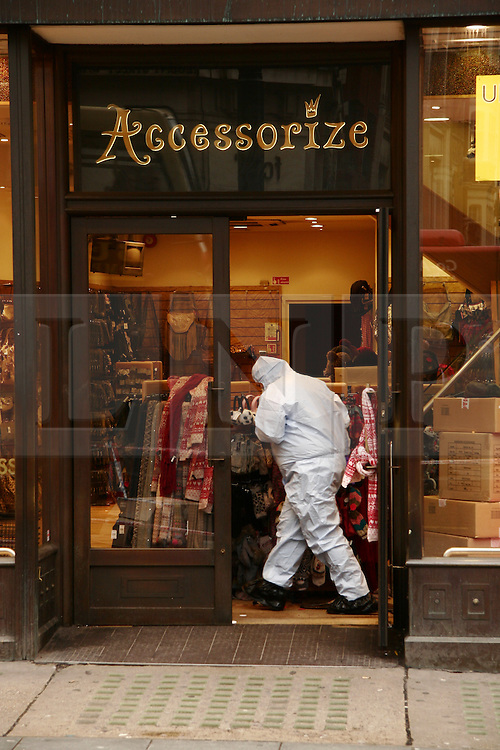 ©London News Picures. 13/01/11 Forensic Support Police Officers at the Accessorize store in Regent Street, London UK, today (Thurs) after a man broke into the store overnight in central London and threatened to blow himself up. Photo credit should read Craig Shepheard / London News Pictures