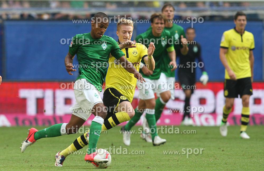 Football: Liga Total Cup 2012, BVB Borussia Dortmund - SV Werder Bremen, Hamburg, 05.08.2012.Theodor Gebre Selassie (Werder, l.) - Marco Reus (BVB).©Êpixathlon