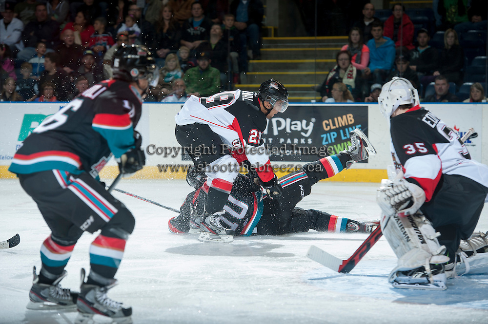 KELOWNA, CANADA - OCTOBER 19: Raymond Grewal #29 of the Prince George Cougars checks Nick Merkley #10 of the Kelowna Rockets on October 19, 2013 at Prospera Place in Kelowna, British Columbia, Canada.   (Photo by Marissa Baecker/Shoot the Breeze)  ***  Local Caption  ***   Raymond Grewal; Nick Merkley;