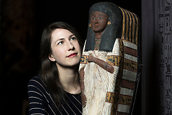 An exhibition at the National Museum of Scotland tells the story of one ancient Egyptian tomb across 1,000 years of use. Built around 1290 BC, the tomb was reused a number of times before being sealed in the 1st Century AD and left undisturbed until its excavation in the 19th Century<br /> <br /> Pictured: Dr Margaret Maitland, Senior Curator, Ancient Mediterranean at National Museums of Scotland with  Wooden coffin of a girl called Tairtsekher