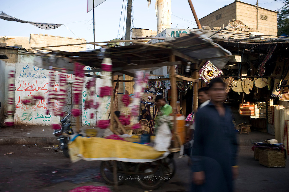 A flower stand where guirlands are sold for wedding and funeral ceremonies. Karachi, Pakistan
