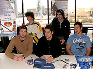 Dayton Gems forwards (from left at table) .Corey Couturier, Jonathan Ornelas, Mike Vaskivuo and Sam Bloom (back right) sit for photos with fans and sign autographs at Brixx Ice Company, Tuesday, January 19, 2010.