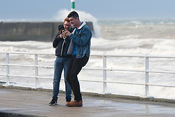 © Licensed to London News Pictures. 21/09/2018. Aberystwyth, UK. People feel the force of the strong wind as Storm Bronagh, the second named storm of the UK winter , increases in intensity with gusts of over 50mph by mid-morning in Aberystwyth .Photo credit: Keith Morris/LNP