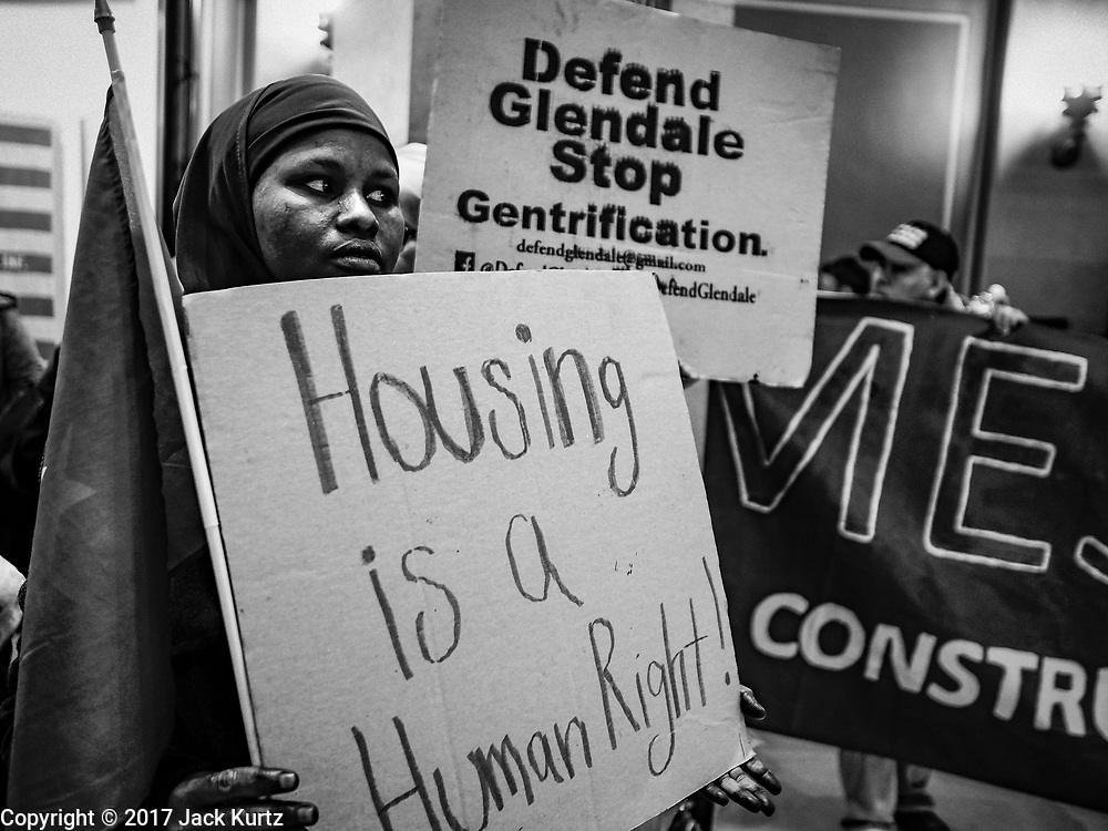 01 MAY 2017 - ST. PAUL, MN: Somali immigrants participate in a May Day immigrants' rights protest in the Minnesota State Capitol. Glendale is a public housing complex that is being renovated and gentrified. The residents there now, including many Somalis, will lose their homes when the renovations are finished. About 300 people, representing immigrants' and workers' rights organizations, marched through the Minnesota State Capitol during a demonstration to mark May Day, International Workers' Day.      PHOTO BY JACK KURTZ