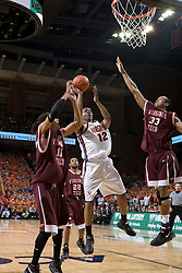 Virginia Cavaliers forward Jamil Tucker (12)  shoots over Virginia Tech Hokies forward Coleman Collins (33).  The Virginia Cavaliers Men's Basketball Team defeated the Virginia Tech Hokies 69-56 at the John Paul Jones Arena in Charlottesville, VA on March 1, 2007.