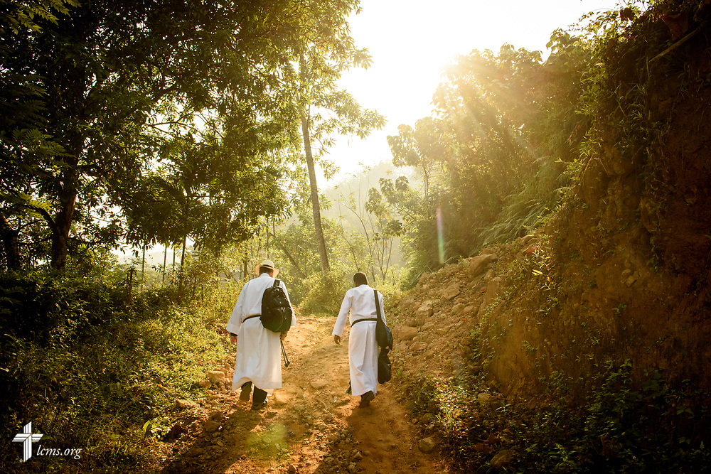 The Rev. Steven Mahlburg (with hat), LCMS career missionary to Sri Lanka, and the Rev. P. Gnanakumar, walk  to the Eila rubber plantation for worship in the Sabaragamuwa Province of Sri Lanka on Sunday, Jan. 21, 2018. LCMS Communications/ Erik M. Lunsford