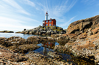 Fisgard Lighthouse is the oldest lighthouse on the west coast of Canada. It was originally built to help guide ships through the mouth of Esquimalt harbour. It remains today as a National Historic Site operated by Parks Canada.<br /> <br /> ©2019, Sean Phillips<br /> http://www.RiverwoodPhotography.com