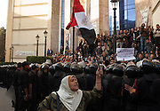An Egyptian flag bearing woman chants anti-Mubarak slogans during continuing January 26, 2011 demonstrations outside the Journalists' Union building in downtown Cairo, Egypt. A series of unprecedented demonstrations have broken out across Egypt for the past two days, inspired by the revolution in Tunisia, and intended to spark a similar movement in Egypt.(Photo by Scott Nelson)