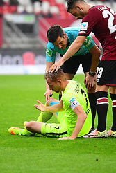 12.08.2016, Grundig Stadion, Nuernberg, GER, 2. FBL, 1. FC Nuernberg vs 1. FC Heidenheim, 2. Runde, im Bild Marc Schnatterer (1. FC Heidenheim) sitzt nach einem Zweikampf am Boden. Schiedsrichter Harm Osmers und Tim Leibold (1. FC Nuernberg) stehen bei ihm. // during the 2nd German Bundesliga 2nd round match between 1. FC Nuernberg and 1. FC Heidenheim at the Grundig Stadion in Nuernberg, Germany on 2016/08/12. EXPA Pictures © 2016, PhotoCredit: EXPA/ Eibner-Pressefoto/ Merz<br /> <br /> *****ATTENTION - OUT of GER*****