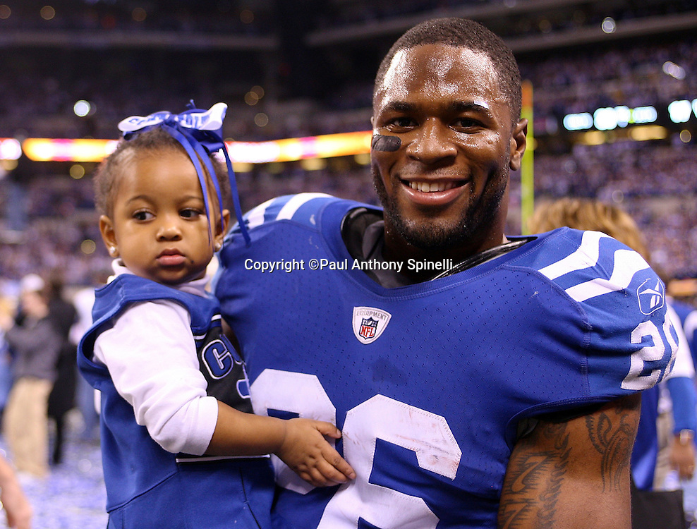 Indianapolis Colts cornerback Kelvin Hayden (26) holds who appears to be his daughter after the AFC Championship football game against the New York Jets, January 24, 2010 in Indianapolis, Indiana. The Colts won the game 30-17. ©Paul Anthony Spinelli