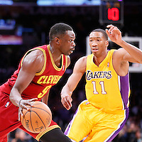 14 January 2014: Cleveland Cavaliers small forward Luol Deng (9) drives past Los Angeles Lakers shooting guard Wesley Johnson (11) during the Cleveland Cavaliers 120-118 victory over the Los Angeles Lakers at the Staples Center, Los Angeles, California, USA.