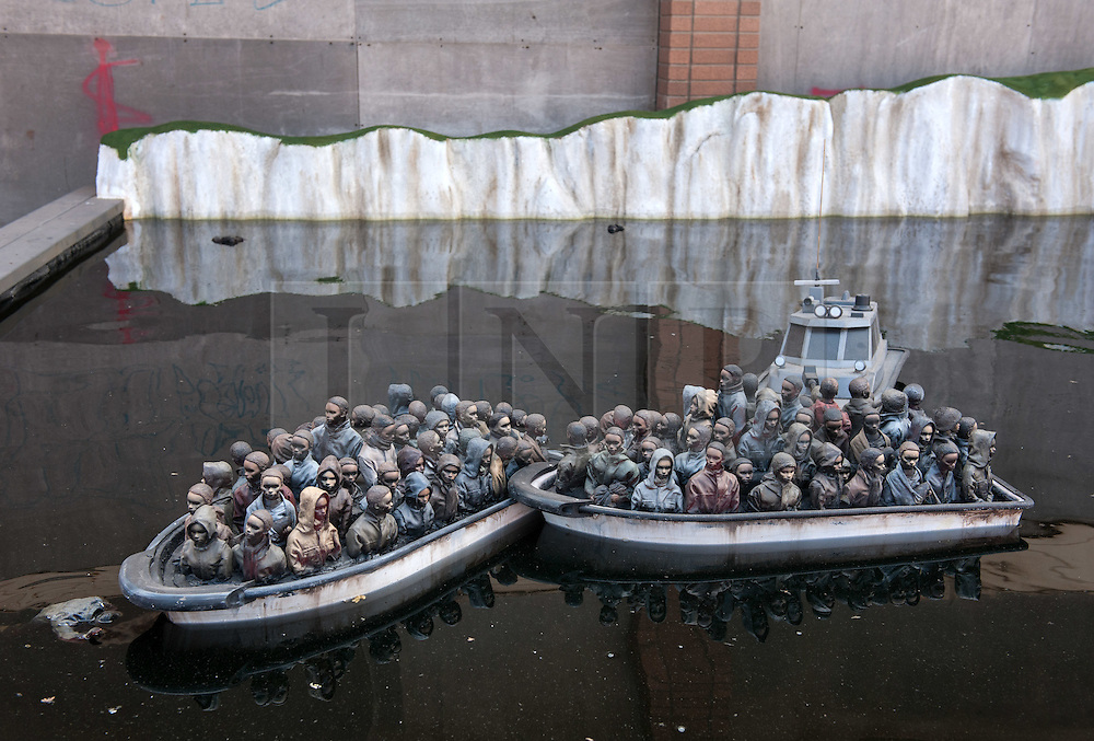 © Licensed to London News Pictures. 22/08/2015. Weston-super-Mare, North Somerset, UK.  Boats full of migrants by the white cliffs of Dover on the first main day of BANKSY's Dismaland show at the old Tropicana on Weston seafront, when the event is open to the general public. Photo credit : Simon Chapman/LNP