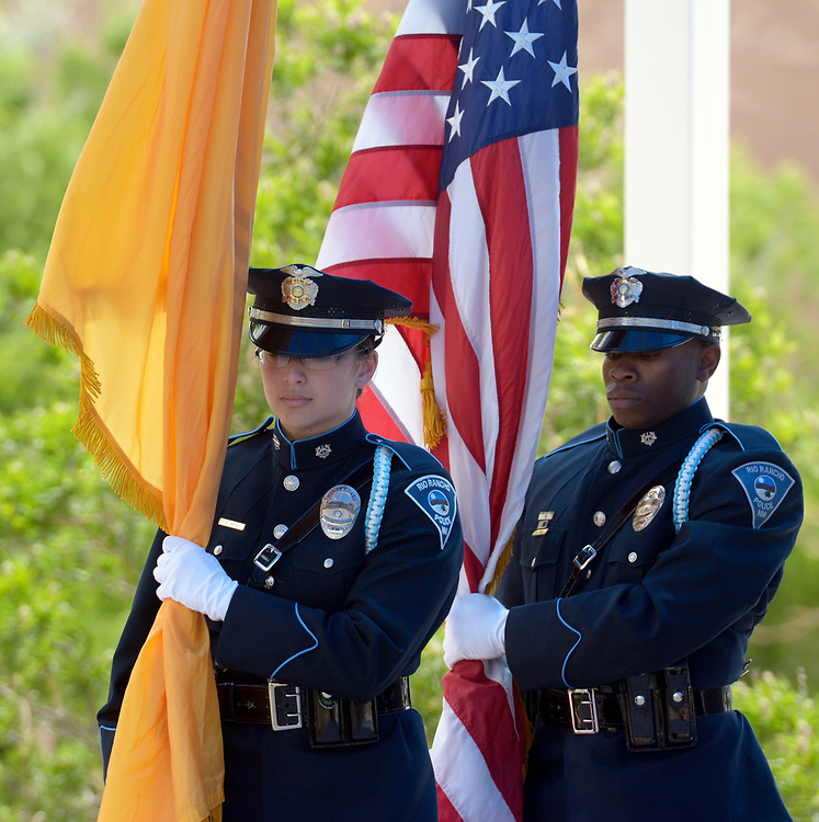 gbs052517c/RIO-WEST -- Officers with the Rio Rancho Police Department Honor Guard, Robyn Carter, left, and L.J. Samuel carry the flags during the Memorial Service honoring officers who have died in the line of duty at the Rio Rancho Memorial Park on Thursday, May 25, 2017. (Greg Sorber/Albuquerque Journal)
