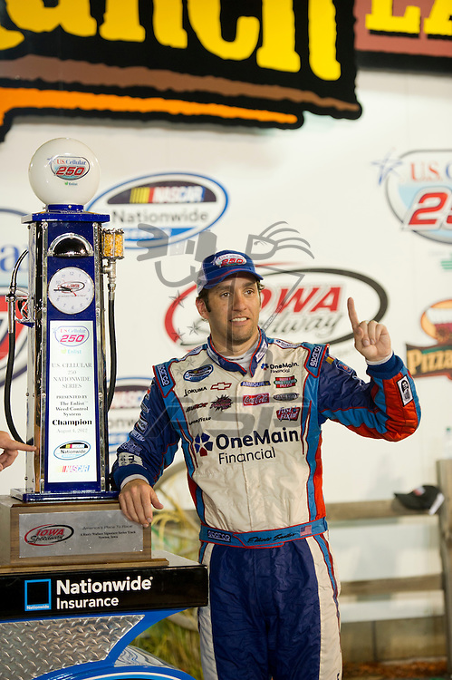 NEWTON, IA - July 04, 2012: Elliot Sadler (2) wins the U.S. Cellular 250 race at Iowa Speedway in Newton, IA.